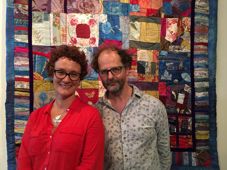 Lois and Phil with Fresh Air & Poverty quilt